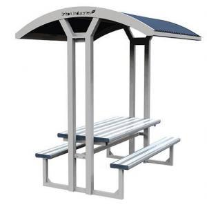 A deluxe sheltered park setting of heavy duty table, shelter and seating.